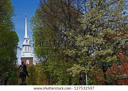Paul Revere statue and Old North Church in Boston - stock photo