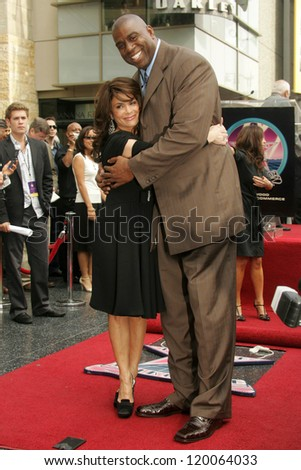 Paula Abdul and Magic Johnson at the Ceremony Honoring Los Angeles Lakers Owner Jerry Buss with the 2,323rd star on the Hollywood Walk of Fame. Hollywood Boulevard, Hollywood, CA. 10-30-06 - stock photo