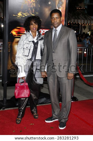 Pauletta Pearson and Denzel Washington  at the Los Angeles premiere of 'Unstoppable' held at the Regency Village Theatre in Westwood on October 26, 2010.  - stock photo