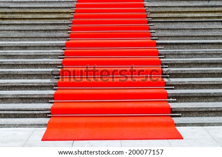 pave in red carpet stairs entrance  - stock photo
