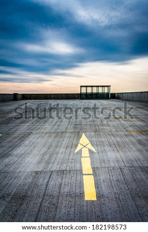 Paved arrow on the roof of a parking garage in Harrisburg, Pennsylvania. - stock photo