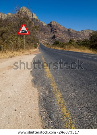 Paved road in the Drakensberg Mountains, South Africa  - stock photo
