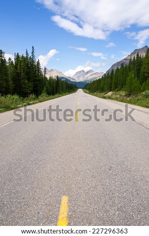 paved road on the Icefield Parkway in Alberta  - stock photo
