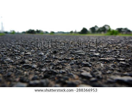 Paved roads with some fine grain in it - stock photo