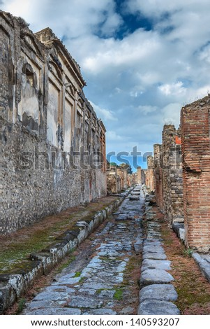 Paved street at the ancient Roman city of Pompeii, which was destroyed and buried during the eruption of Mount Vesuvius in 79 AD - stock photo