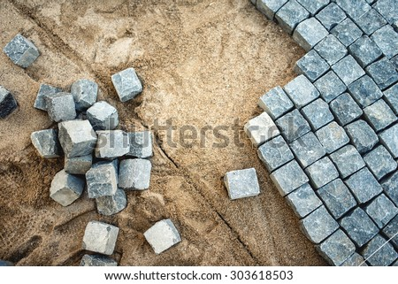 Pavement rocks, stones and cobblestone blocks, construction of path, road or sidewalk - stock photo