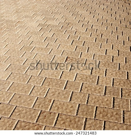 pavement with paving brown stones texture background - stock photo