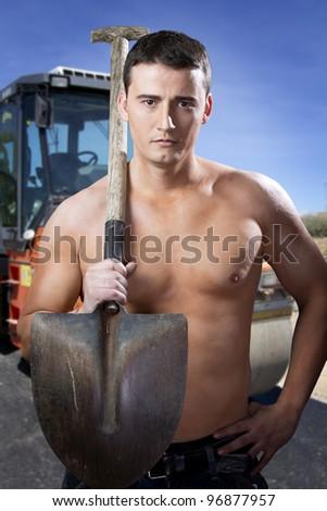 Paver on job. Constructing a new street - stock photo