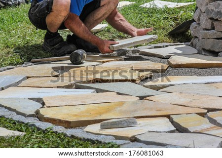Paver with marble plates - stock photo