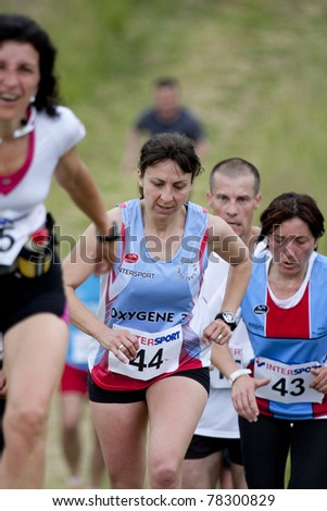 PAVIE, FRANCE - MAY 22: Lapart Cathy shown during the Trail of Pavie Marathon on May 22, 2011 in Pavie, France. - stock photo