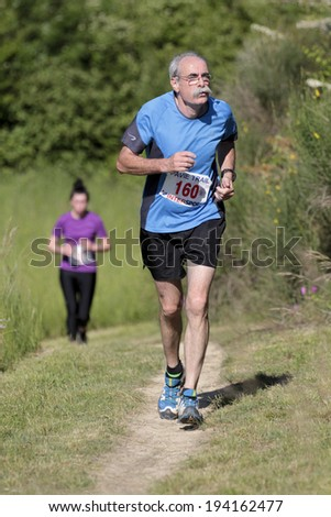PAVIE, FRANCE - MAY 18: Portrait of an elderly runner at the Trail of Pavie, on May 18, 2014, in Pavie, France.  - stock photo