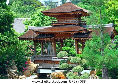 Pavilion and green trees at day - stock photo