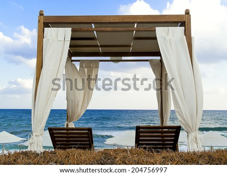 Pavilion for relax on the beach in resort. Early morning. - stock photo