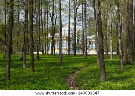 Pavilion in Catherine`s park in Tsarskoe Selo near Saint Petersburg, Russia through the woods - stock photo