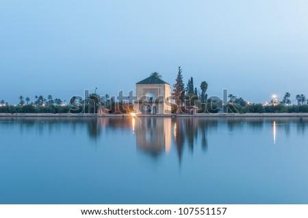 Pavillion reflection on Menara Gardens basin at Marrakech, Morocco - stock photo