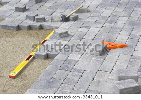 Paving Backyard patio with level and line - stock photo