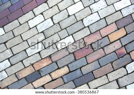 Paving blocks made of rectangular colored stones - stock photo