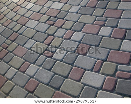 Paving blocks / stones on the road. Colored paving paved at an angle in the different forms. Fragment of stacked cover from the pressed blocks. detail of a pavement to walk, textured background. - stock photo