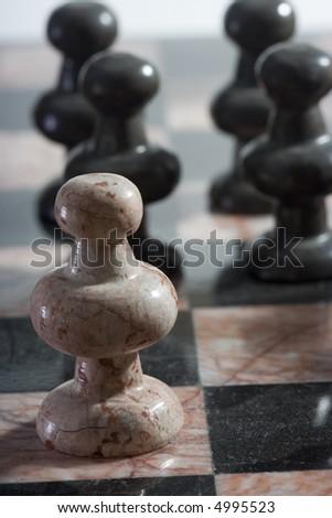 Pawn confrontation II - stock photo