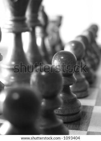 pawn pieces in a row - stock photo