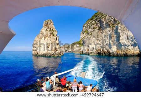 Paxos and Antipaxos island cliff as seen from a daily cruise boat near the island of Corfu Greece - stock photo