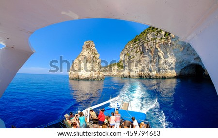 Paxos and Antipaxos island cliff as seen from a daily cruise boat near the island of Corfu Greece. Panoramic view. - stock photo