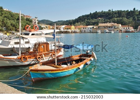 PAXOS, GREECE - JUNE 21, 2014: Small boats moored in the harbour at Lakka on the Greek island of Paxos. Lakka is the Northern harbour of the 13km long Ionian island. - stock photo