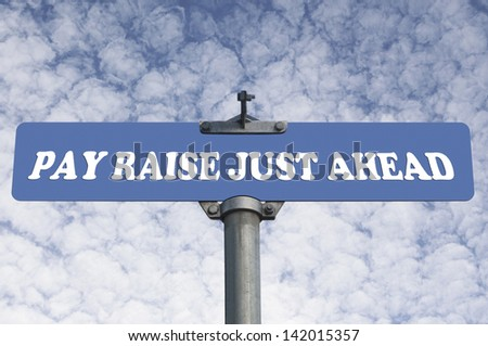Pay raise just ahead road sign - stock photo