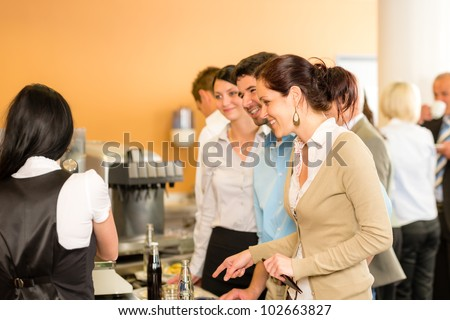 Paying at cafeteria woman cashier serve woman food and drinks - stock photo