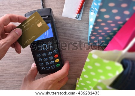 Payment in a trade with contactless card. Top view,vertical composition - stock photo