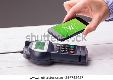 Payment screen against man using smartphone to express pay - stock photo