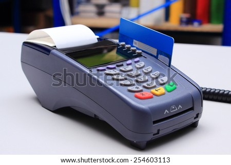 Payment terminal with credit card on desk in store, credit card reader, payment terminal, finance concept - stock photo