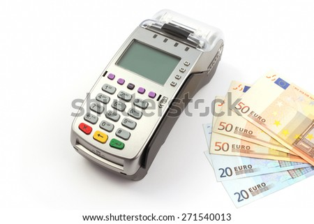 payment terminal with money isolated on white background - stock photo
