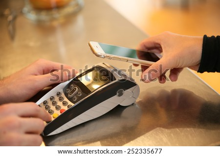 Payment transaction with smartphone  - stock photo
