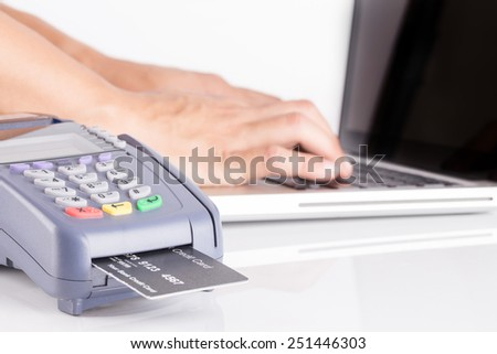 payment with a credit card through terminal - stock photo