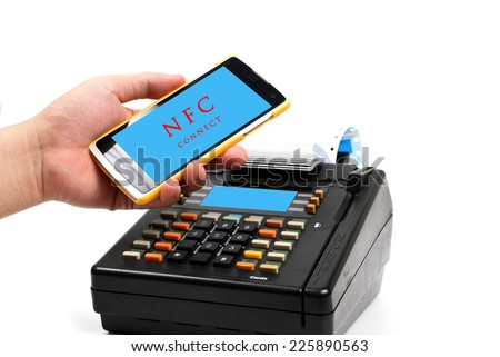 payment with a mobile phone by NFC Technology isolated on white. - stock photo