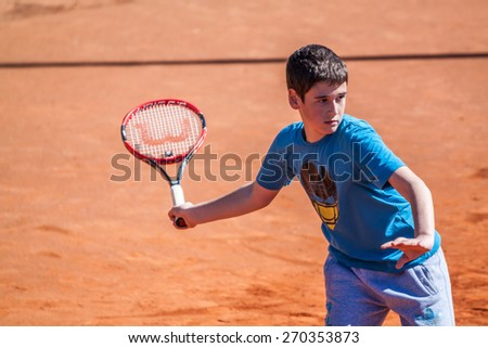 PAZARDZHIK, BULGARIA - APRIL 04, 2015 - Tennis tournament for children till 14 years of age - 04 April 2015. The competition was held on Pazardzhik tennis club courts. - stock photo