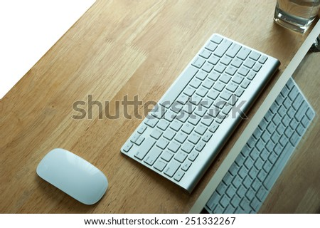 PC, Keyboard and mouse on wooden desk - stock photo
