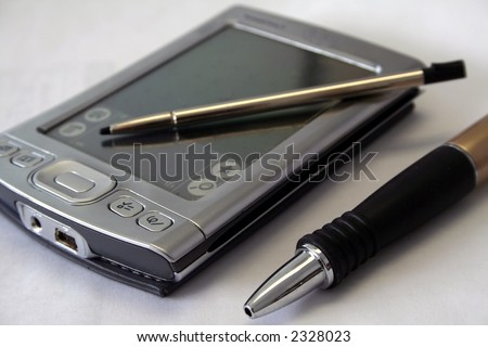 PDA, stylus pen, and pen - stock photo