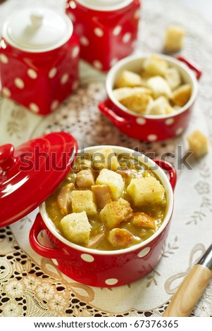 Pea cream soup with smoked chicken and croutons - stock photo