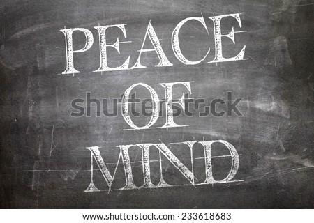 Peace of Mind written on blackboard - stock photo