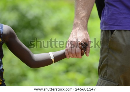 Peace on Earth Symbol - Different Cultures Holding Hands Sharing Lifestyle Experience - stock photo