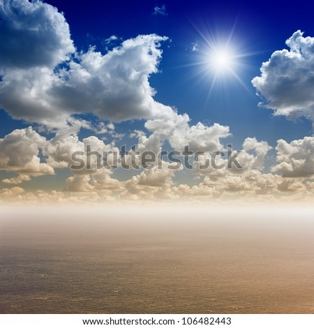 Peaceful background - bright sun shines in blue sky, white clouds above sea - paradise, heaven - stock photo