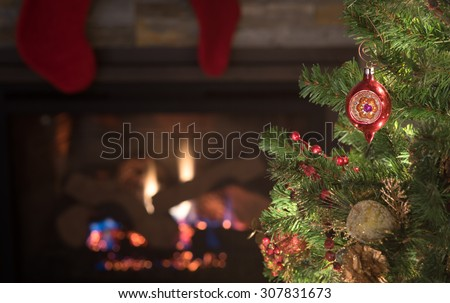Peaceful Christmas Tree Scene with Vintage Red Ornament, stockings, lights, fireplace, dried cranberries with background room or space for copy, text, your words. Horizontal dark moody closeup. - stock photo
