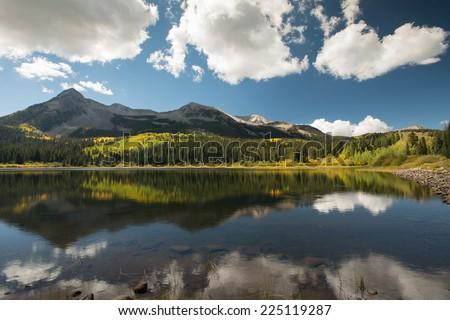 peaceful double dollar lake in colorado in autumn - stock photo