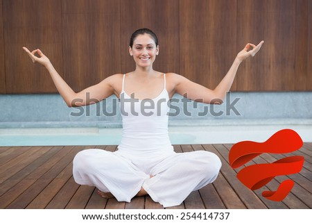 Peaceful happy woman in white sitting in lotus pose against heart - stock photo