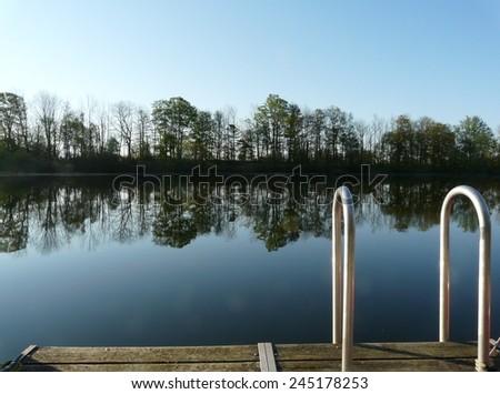 Peaceful lake in the morning calm, near Stratford, Ontario, Canada - stock photo