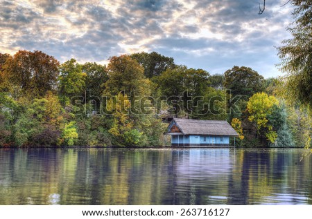 Peaceful lake view with old cabin on Herastrau lake in Bucharest, Romania - stock photo
