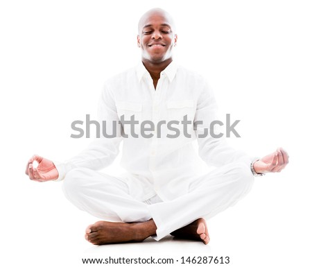 Peaceful man doing yoga and meditating - isolated over a white background - stock photo