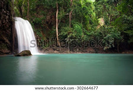 Peaceful nature background of waterfall in forest - stock photo